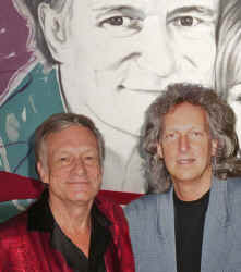 Me and Hef with anniversary portrait web close up.jpg (265521 bytes)